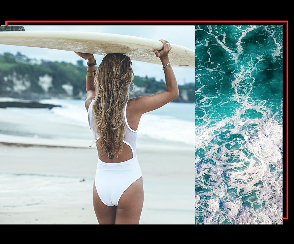 woman surfer walking on the beach